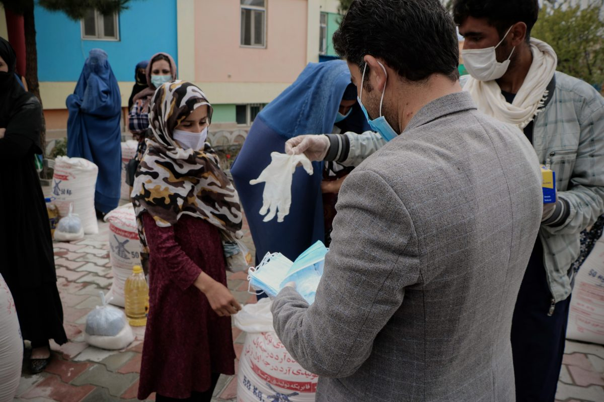 Abdul Fatah is distributing the Masks and Gloves to the widows and Orphans (1)