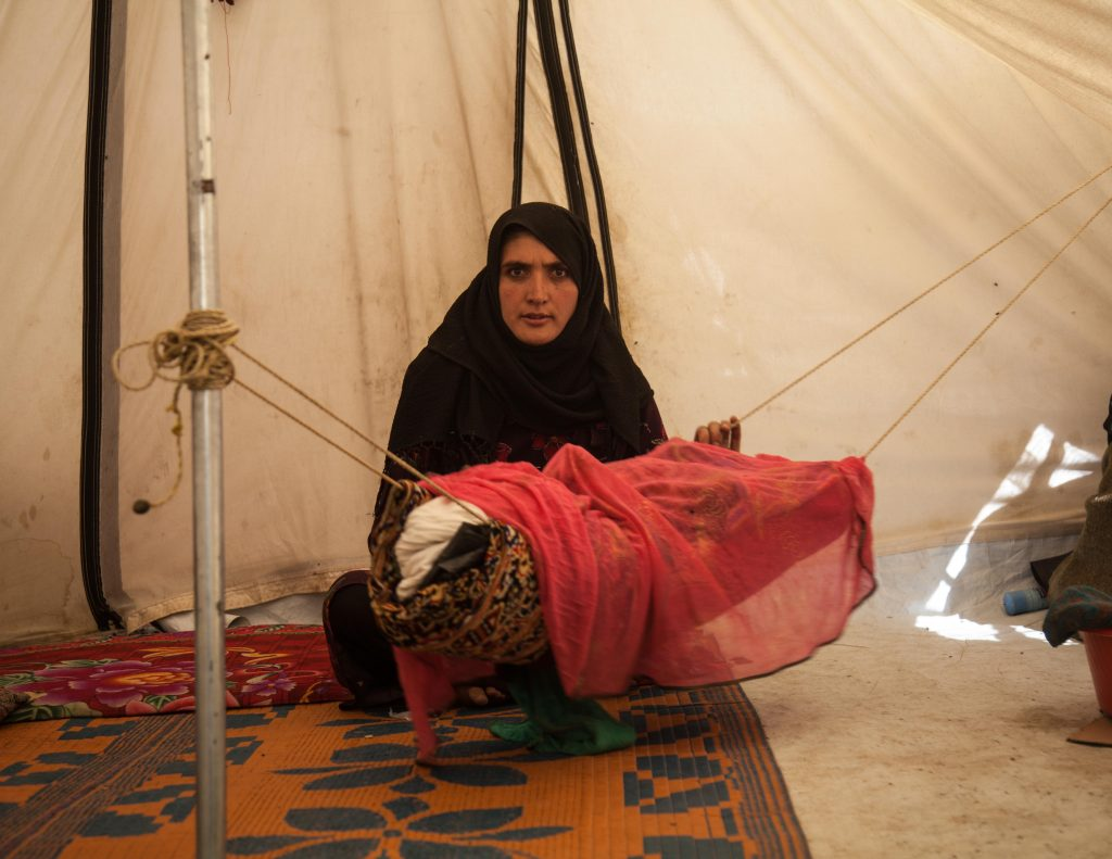 'Woman with child in tent' Mahboba's Promise Afghanistan 2021