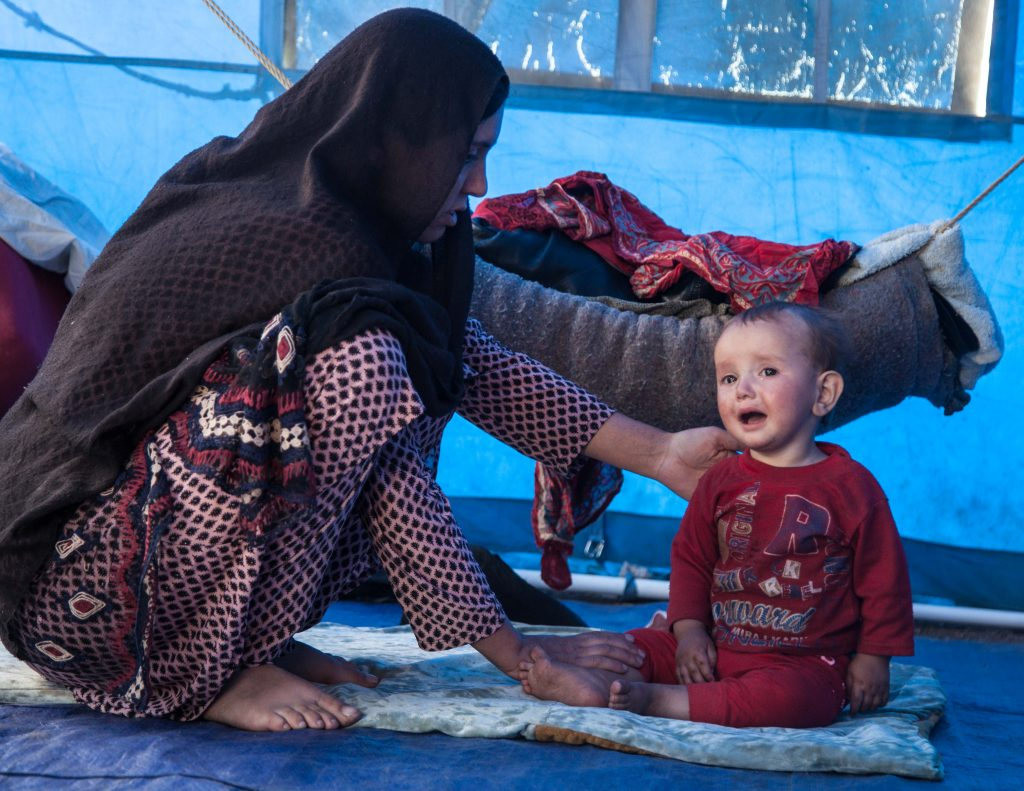 'Woman with child in tent home' Mahboba's Promise Afghanistan 2021